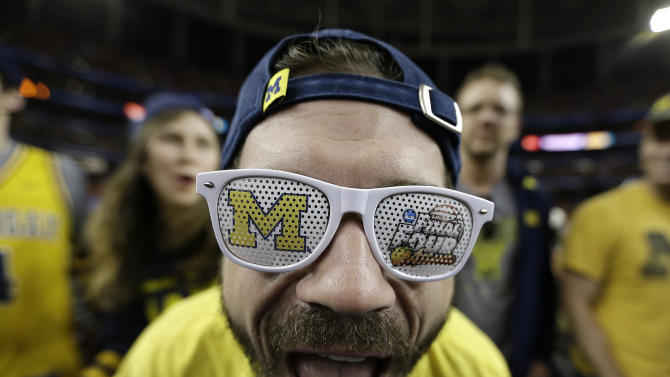 Michigan student Aaron Ruhlig cheers before the first half of the NCAA Final Four tournament college basketball semifinal game against Syracuse, Saturday, April 6, 2013, in Atlanta. (AP Photo/Charlie Neibergall)