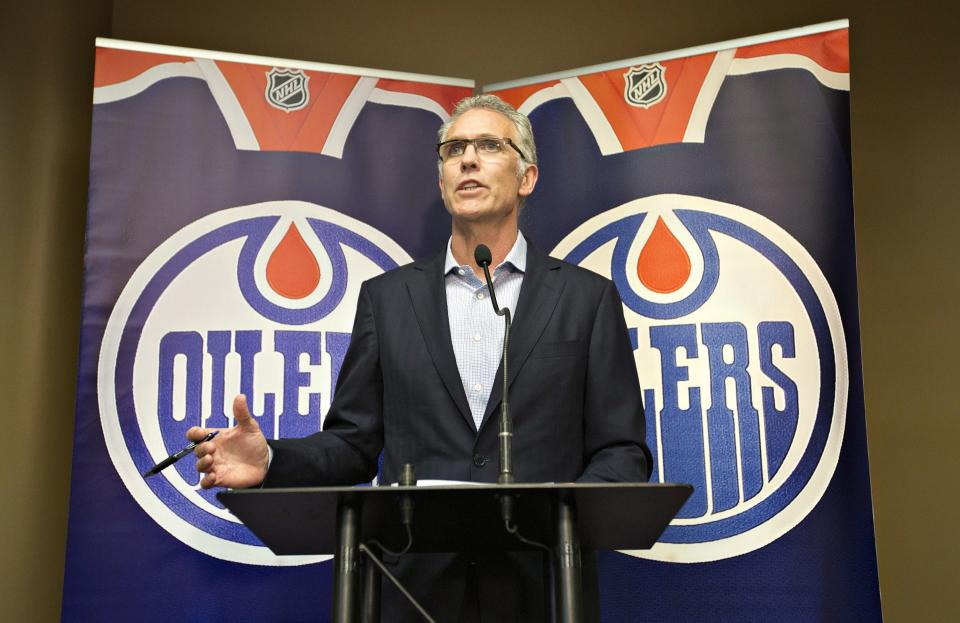 Edmonton Oilers general manager Craig MacTavish announces the firing of head coach Ralph Krueger during an NHL hockey news conference in Edmonton, Alberta, on Saturday, June 8, 2013. (AP Photo/The Canadian Press, Jason Franson)