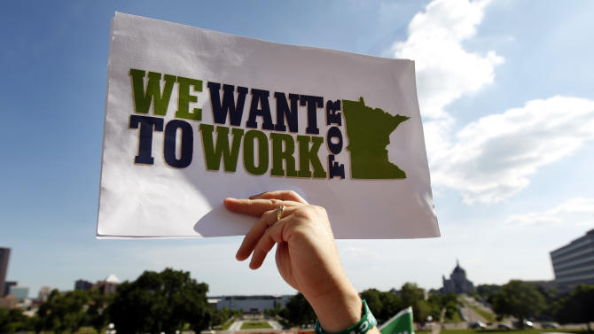 Protestors hold signs during a rally at the Minnesota State Capitol, Wednesday, July 6, 2011,  in St. Paul, Minn. Minnesota stands to lose tens of millions of dollars in the nation's only state government shutdown, as lottery tickets go unpurchased, tax cheats go unpursued and 22,000 laid-off state workers collect unemployment and health benefits. (AP Photo/The Star Tribune, Carlos Gonzalez)  MANDATORY CREDIT; ST. PAUL PIONEER PRESS OUT; MAGS OUT; TWIN CITIES TV OUT