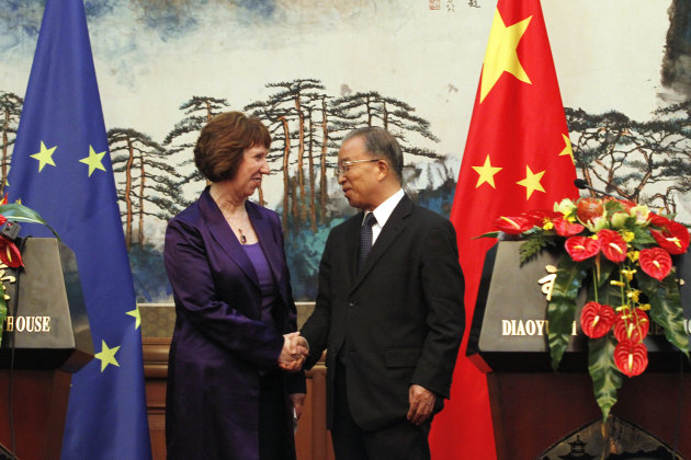 EU foreign policy chief Catherine Ashton, left, shakes hand with Chinese State Councilor Dai Bingguo after a press briefing at the Diaoyutai State Guest House in Beijing, Tuesday, July 10, 2012. (AP Photo/Ng Han Guan, Pool)