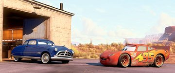 Doc Hudson (voiced by Paul Newman ) and Lightning McQueen (voiced by Owen Wilson ) in Disney's presentation of Pixar's Cars