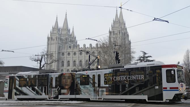 The downtown light rail rolls pass The Salt Lake Temple Wednesday, Jan. 9, 2013, in Salt Lake City.  Built with the 2002 Winter Olympics in mind, Salt Lake City's light-rail network is free for passengers as it weaves through downtown. Riders can get to and from major attractions such as Temple Square, City Creek Center, Salt Lake City Library, Energy Solutions Arena and the Gateway for free. An extension leading to the airport is expected to open this spring, but that trips on that section will cost riders.  (AP Photo/Rick Bowmer)