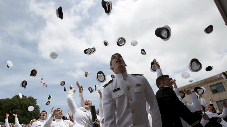 New graduates of the United States Merchant Marine Academy toss their hats in the air to celebrate their graduation in Kings Point, N.Y., Monday, June 18, 2012.   (AP Photo/Seth Wenig)