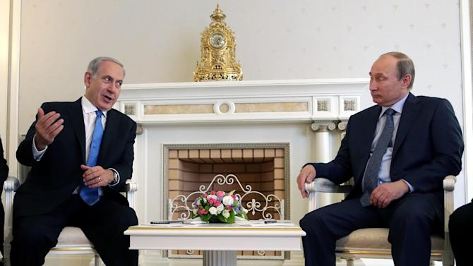Russian President Vladimir Putin, right, listens to Israeli Prime Minister Benjamin Netanyahu during their meeting at the Bocharov Ruchei residence in the Black Sea resort of Sochi, Russia, Tuesday, May 14, 2013. Putin is hosting Netanyahu for talks focusing on the situation in Syria, amid concerns that Moscow could soon provide Damascus with advanced missiles. (AP Photo/ Maxim Shipenkov, Pool)