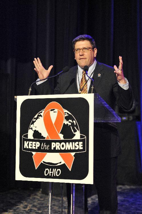 """Cleveland City Council member Joe Cimperman addresses the crowd seen at the AIDS Healthcare Foundation's """"Keep The Promise On AIDS"""" March and Rally, on Saturday, May 11, 2013 in Cleveland, Ohio. (David Richard /AP Images for AIDS Healthcare Foundation)"""