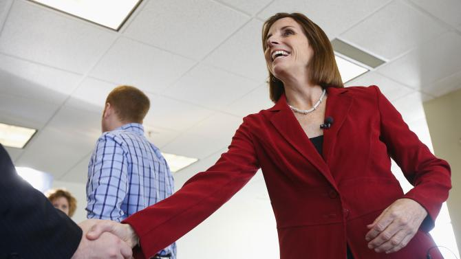 Republican Martha McSally smiles as she shakes hands after learning that an election recount gave her a 167-vote Congressional victory against Democratic incumbent Rep. Ron Barber, at McSally's campaign headquarters Wednesday, Dec. 17, 2014, in Tucson, Ariz.  Republicans will have their largest U.S. House majority in 83 years when the new Congress convenes next month after a recount in Arizona gave the final outstanding race to the Republican challenger. (AP Photo/Ross D. Franklin)