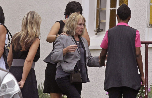 June Steenkamp, center, the mother of Reeva Steenkamp, arrives for her funeral in Port Elizabeth, South Africa, Tuesday, Feb. 19, 2013. Olympic athlete Oscar Pistorius is charged with the premeditated