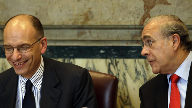 Angel Gurria, Secretary-General of the Organization for Economic Co-operation and Development (OECD), right, and Italian Premier Enrico Letta share a laugh  during the Economic Survey of Italy forum in Rome, Thursday, May 2, 2013.  (AP Photo/Gregorio Borgia)
