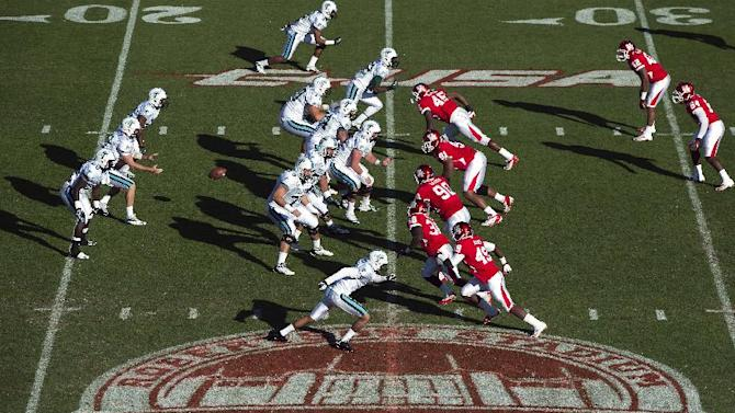 Tulane quarterback Ryan Griffin, center left, takes a snap against Houston as play takes place over a logo commemorating the final game at Robertson Stadium during the first half of an NCAA college football game, Saturday, Nov. 24, 2012, in Houston. The stadium, which officially opened in 1942, will be demolished and replaced with a state-of-the-art facility in time for the 2014 football season. Houston defeated Tulane 40-17. Houston finished 72-44-1 all-time at Robertson. (AP Photo/Houston Chronicle, Smiley N. Pool) MANDATORY CREDIT.