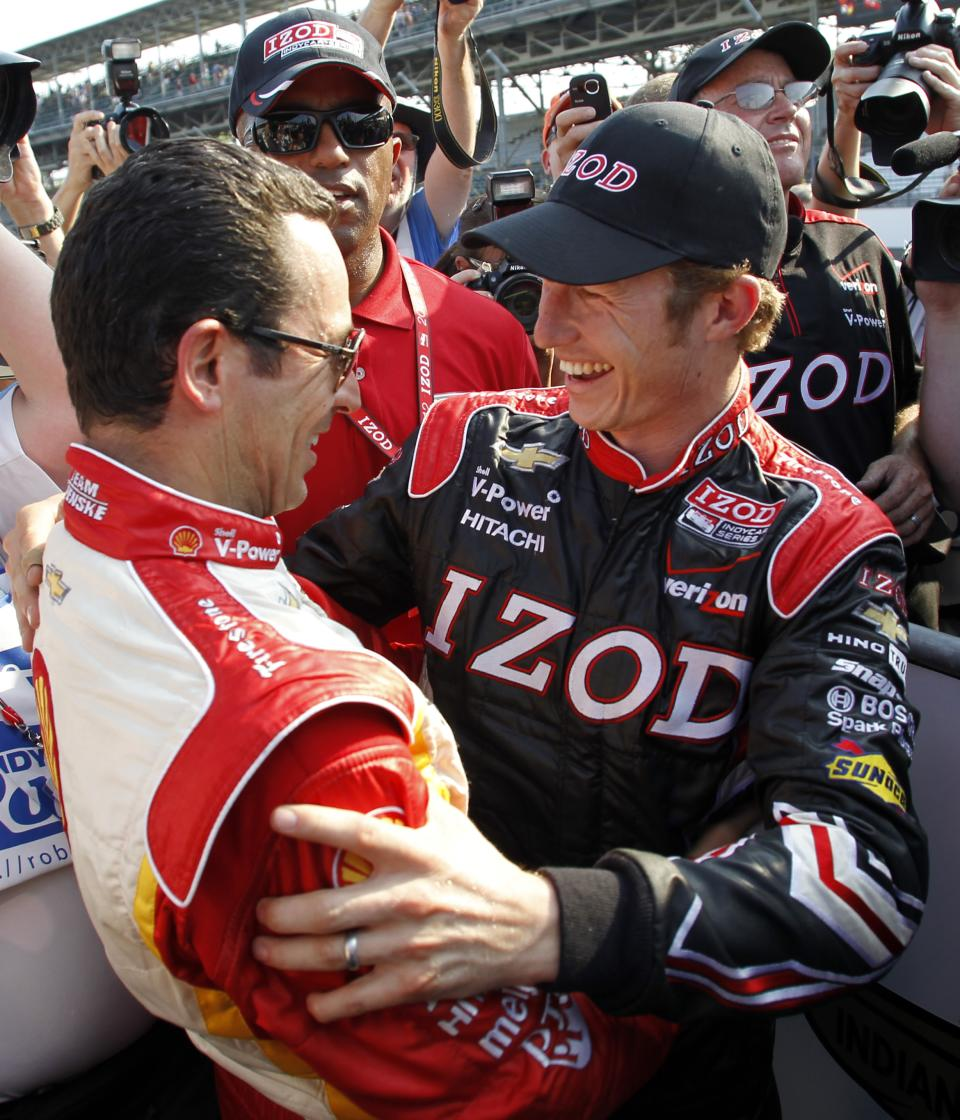 IndyCar driver Ryan Briscoe, right, of Australia, celebrates winning the pole with teammate Helio Castroneves, of Brazil, on the first day of qualifications for the Indianapolis 500 auto race at the Indianapolis Motor Speedway in Indianapolis, Saturday, May 19, 2012. (AP Photo/Tom Strattman)