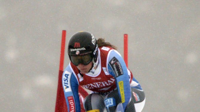 Stacey Cook, of the United States, speeds down the course at the women's World Cup downhill ski race in Lake Louise, Alberta, Friday, Nov. 30, 2012. (AP Photo/The Canadian Press, Jonathan Hayward)