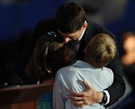 Republican vice presidential nominee Paul Ryan hugs his daughter Liza (L) and son Charlie after his speech at the Tampa Bay Times Forum in Tampa, Florida, on August 29, during the Republican National Convention. Ryan energized Mitt Romney's White House bid with a scathing take-down of Barack Obama's economic record as he accepted the vice presidential nomination