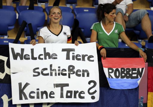 German fans hold banners before the Euro 2012 soccer match between Netherland and Germany in Kharkiv