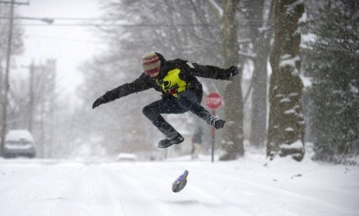 <p>A teenager snowboards down the road December 26, 2012 in Pittsburgh, Pennsylvania. The US northeast was battered by heavy snow and strong winds as a powerful storm carved a violent arc across several states, killing more than a dozen people and snarling holiday travel.</p>
