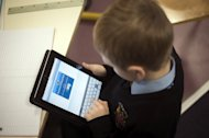 A student is seen using an iPad digital tablet at the British School of Paris, in Croissy-sur-Seine. Instead of textbooks, the pupils at the school are now pouring over tablet computers linked in to a wireless broadband network