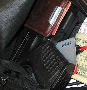 This handout photo provided by the Transportation Security Administration (TSA), taken in April 2013 at Indianapolis International Airport, shows a gun among personal belongings that was confiscated in a carry-on bag at the airport. _ Several times every day, at airports across the country, passengers try to walk through security screening with loaded guns in carry-on bags, a purse, a pocket, even a boot. And, nearly a dozen years after 9/11, it's happening a lot more often. In the first six months of this year, Transportation Security Administration screeners found 894 guns on passengers or in their carry-on bags, a 30 percent increase over the same period last year. The TSA set a record in May for the most guns seized in one week _ 65 in all, 45 of them loaded and 15 with bullets in their chambers and ready to be fired. That was 30 percent more than the previous record of 50 guns, set just two weeks earlier. (AP Photo/TSA)