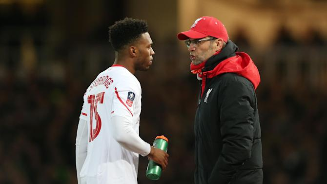 Liverpool manager Juergen Klopp speaks with Daniel Sturridge before he comes on as a substitute