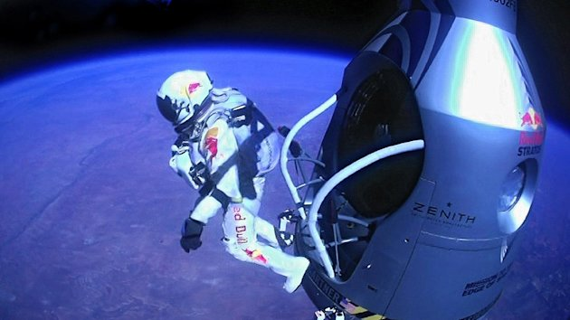 This image provided by Red Bull Stratos shows pilot Felix Baumgartner of Austria as he jumps out of the capsule during the final manned flight for Red Bull Stratos on Sunday, Oct. 14, 2012. In a giant leap from more than 24 miles up, Baumgartner shattered the sound barrier Sunday while making the highest jump ever  a tumbling, death-defying plunge from a balloon to a safe landing in the New Mexico desert. (AP Photo/Red Bull Stratos)