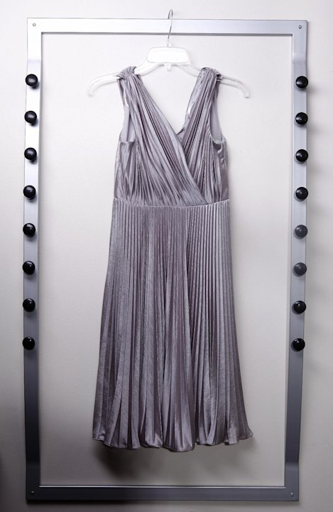 In this March 13, 2012 photo, a platinum dress covered in pleats is displayed in New York. (AP Photo/Carlo Allegri)