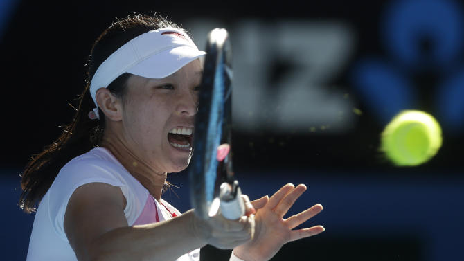 China's Zheng Jie hits a forehand return during her second round win over Australia's Samantha Stosur at the Australian Open tennis championship in Melbourne, Australia, Wednesday, Jan. 16, 2013. (AP Photo/Dita Alangkara)