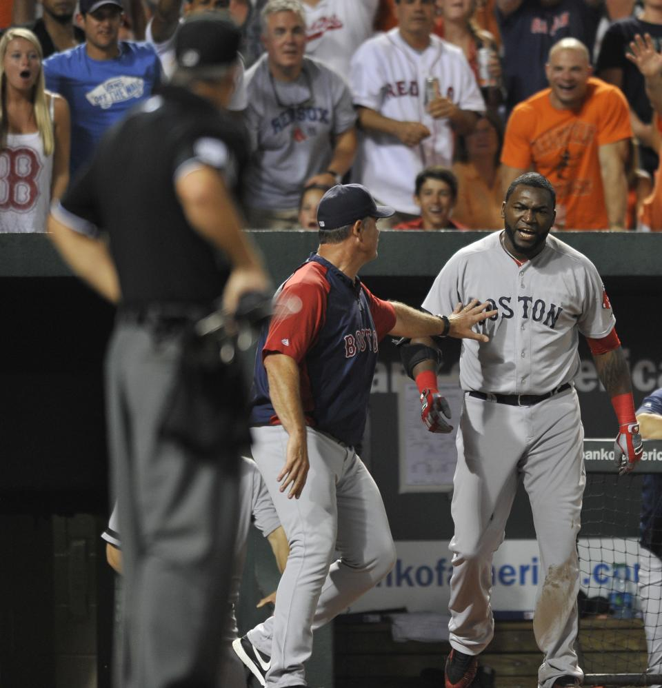 Boston Red Sox designated hitter David Ortiz, right, reacts and is held back by manager John Farrell after being ejected by home plate umpire Tim Timmons, left, in a baseball game against the Baltimore Orioles, Saturday, July 27, 2013, in Baltimore. (AP Photo/Gail Burton)