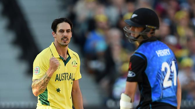 Australia's Mitchell Johnson celebrates after dismissing New Zealand's Matt Henry during the ICC Cricket World Cup final in Melbourne, Australia, Sunday, March 29, 2015. (AP Photo/Andy Brownbill)
