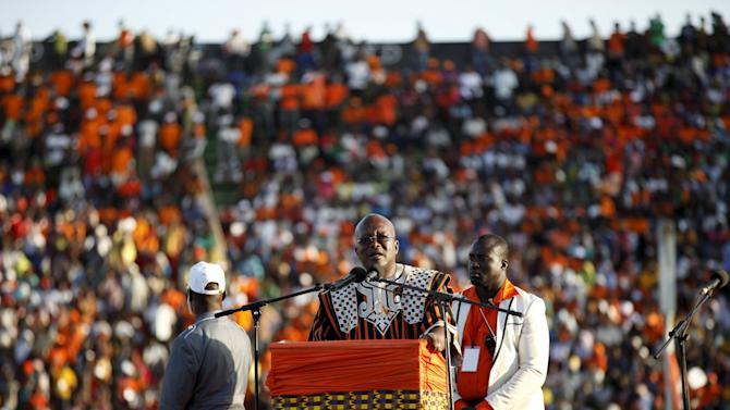 Presidential candidate Roch Marc Kabore speaks to supporters at his last campaign rally in Ouagadougou