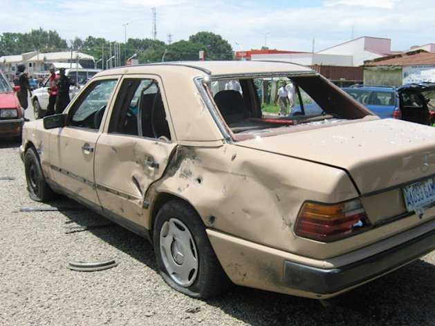 A damaged car seen after a suicide car bomb detonated at a church in Bauchi, Nigeria. Sunday, Sept. 23, 2012. A suicide car bomber attacked a Catholic church in northern Nigeria on Sunday, killing two people and wounding another 45 in a region under assault by a radical Islamist sect, officials said. (AP Photo) EDS NOTE: BEST QUALITY AVAILABLE
