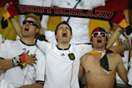 Germany supporters sing their national anthem ahead of the Euro 2012 match against the Netherlands in Kharkiv in June. Germany midfielder Sami Khedira on Tuesday hit back against criticism of players, including himself, who do not sing their national anthem before matches