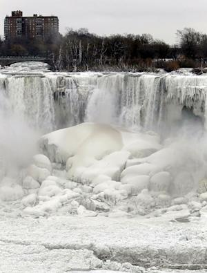 """FILE - This Jan. 10, 2014 file photo shows the US side of Niagara Falls in New York beginning to thaw after the recent """"polar vortex"""" that affected millions in the US and Canada. Remember the polar vortex, the huge mass of Arctic air that can plunge much of the U.S. into the deep freeze? You might have to get used to it. we should see more of these in the future because a study partially links these polar vortex related cold outbreaks to loss of sea ice off Russia as the world gets warmer. But we have to note that last year's polar vortex chill was slightly different and not connected to sea ice loss, researchers say. (AP Photo/Nick LoVerde, File)"""