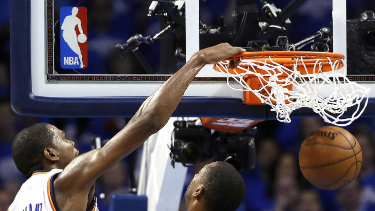 Oklahoma City Thunder forward Kevin Durant dunks in front of Memphis Grizzlies Darrell Arthur during the second half of Game 2 of their Western Conference Semifinals NBA basketball playoff series in Oklahoma City, Tuesday, May 7, 2013.  (AP Photo/Alonzo Adams)