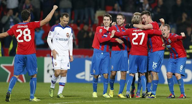 Moscow's Sergei Ignashevich, 2nd right, walks past Viktoria Pilsen players as they celebrate their victory after the Champions League Group D soccer match between Viktoria Pilsen and CSKA Moscow i