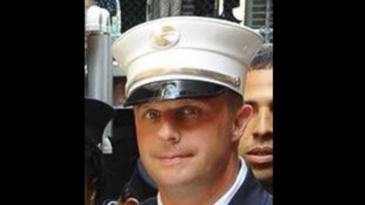 This photo taken on June 26, 2014, and released by the NYFD, shows Lt. Gordon Ambelas, who died at a hospital late Saturday night, July 5, 2014, after battling a blaze that broke out on an upper floor of a Brooklyn public-housing high-rise in New York. Two other firefighters were taken to Bellevue Hospital with minor injuries, and two civilians were treated for minor injuries at area hospitals. (AP Photo/NYFD)