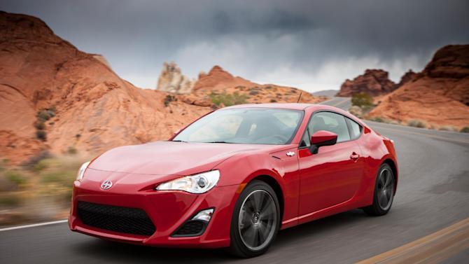 This photo provided by Scion shows Scion's new-for-2013 FR-S sport coupe. the FR-S, for Front-engine, Rear-wheel drive Sport, grabs attention from onlookers no matter who is behind the wheel and even if the car is being driven leisurely. This new model puts some verve into a commute or a trip to the relatives' house, too. (AP Photo/Scion)