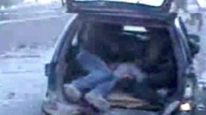 In this image taken from video obtained from Bambuser, which has been authenticated based on its contents and other AP reporting, Syrians help an inured man into a vehicle after an airstrike hit Douma City, Syria on Thursday, Jan. 3, 2013. Airstrikes continued across Syria on Thursday as Syrian President Bashar Assad's military stepped up its assault on areas that surround the nation's capital. (AP Photo/Bambuser via AP video)