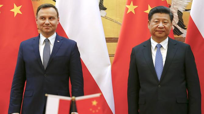 Poland's President Andrzej Duda and his Chinese counterpart Xi Jinping attend a signing ceremony following their meeting at the Great Hall of the People in Beijing