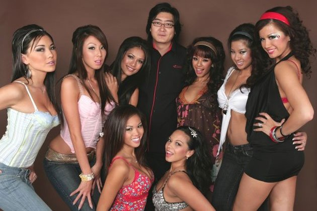 A bevy of girls surround Chris Ang (centre) of SIN. (Three Angles Production)