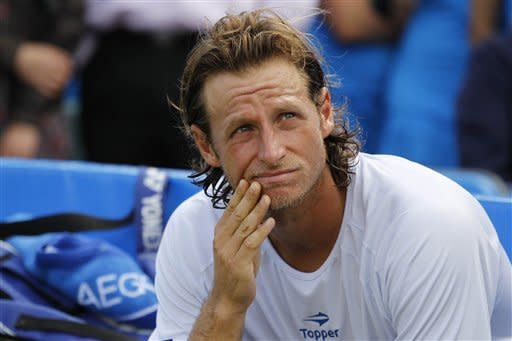 Nalbandian loses Queen's after hurting line judge