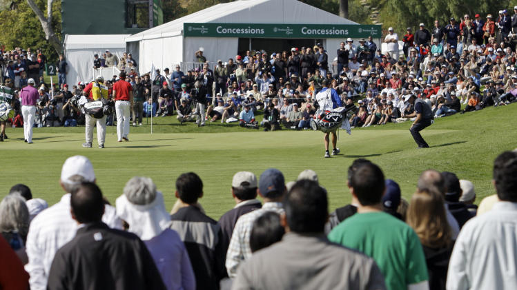 Phil Mickelson, right, reacts to a missed birdie putt on the second green in the final round of the Northern Trust Open golf tournament at Riviera Country Club in Los Angeles, Sunday, Feb. 19, 2012. (AP Photo/Reed Saxon)