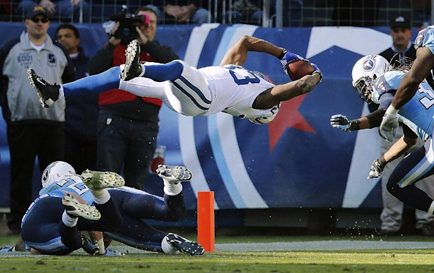 Indianapolis Colts running back Vick Ballard (33) dives into the end zone for a touchdown as Tennessee Titans free safety Michael Griffin, right, defends during overtime of an NFL football game, Sunday, Oct. 28, 2012, in Nashville, Tenn. The Colts won 19-13. (AP Photo/Joe Howell)