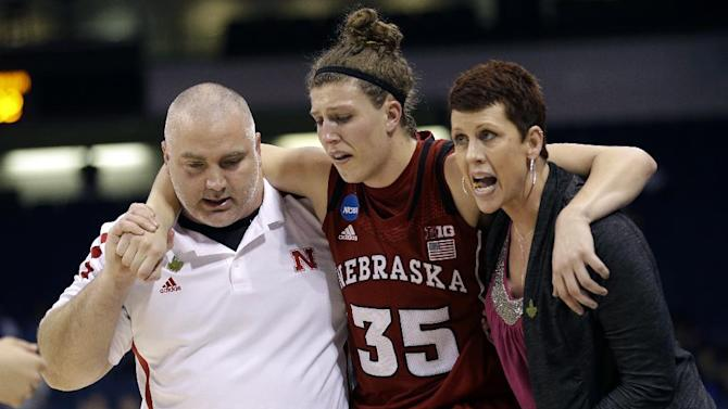 Nebraska forward Jordan Hooper (35) is helped off the court after being injury during the second half of a regional semifinal game against Duke of the women's NCAA college basketball tournament on Sunday, March 31, 2013, in Norfolk, Va.  Duke won 53-45.  (AP Photo/Steve Helber)