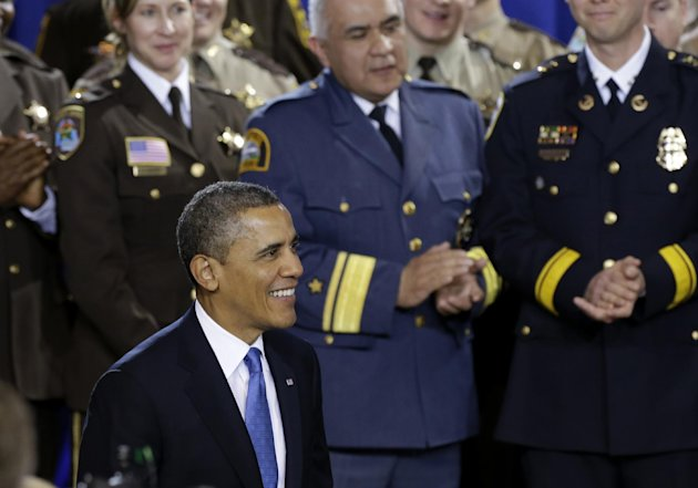 President Barack Obama is applauded prior to speaking about his gun violence proposals, Monday, Feb. 4, 2013, at the Minneapolis Police Department&#39;s Special Operations Center in Minneapolis, where he outlined his plan before law enforcement personnel. (AP Photo/Jim Mone)