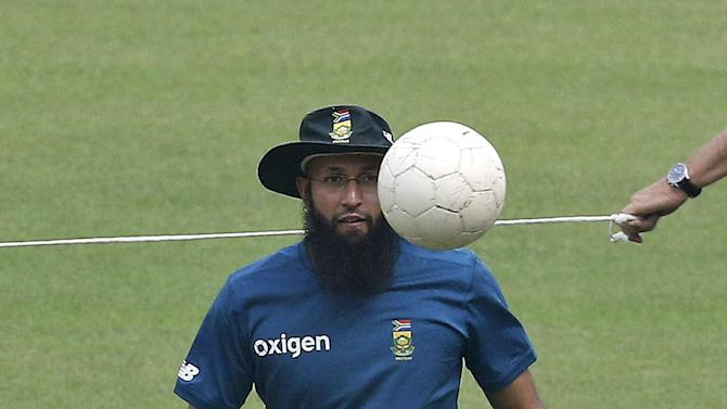 South Africa's Amla plays soccer during a practice session ahead of their Twenty20 cricket match against India in Kolkata