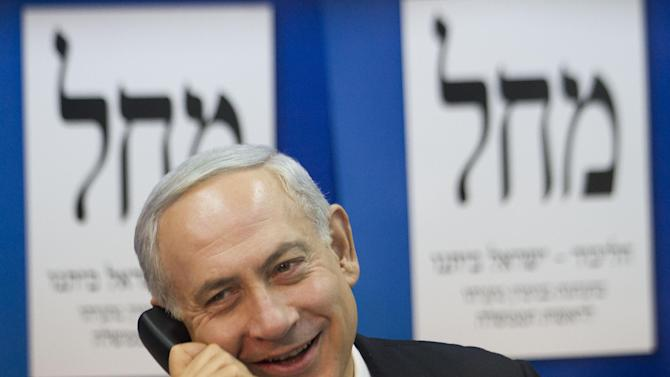 Israel's Prime Minister Benjamin Netanyahu speaks on the phone with Israeli voters persuading them to vote for him in the upcoming Israeli elections in event for the Media in his party headquarters in Tel Aviv, Israel,Thursday, Jan. 17, 2013. Legislative elections in Israel will be held on Jan. 22, 2013. (AP Photo/Ariel Schalit)