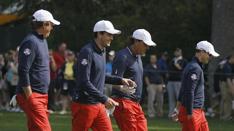USA's Jason Dufner, left to right, Keegan Bradley, Phil Mickelson and Zach Johnson make their way off the fifth tee during a practice round at the Ryder Cup PGA golf tournament Wednesday, Sept. 26, 2012, at the Medinah Country Club in Medinah, Ill. (AP Photo/Charles Rex Arbogast)