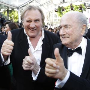 FIFA President Sepp Blatter, right, and actor Gerard Depardieu gives the thumbs up as they arrive for the screening of The Homesman at the 67th international film festival, Cannes, southern France, Sunday, May 18, 2014. (AP Photo/Thibault Camus)