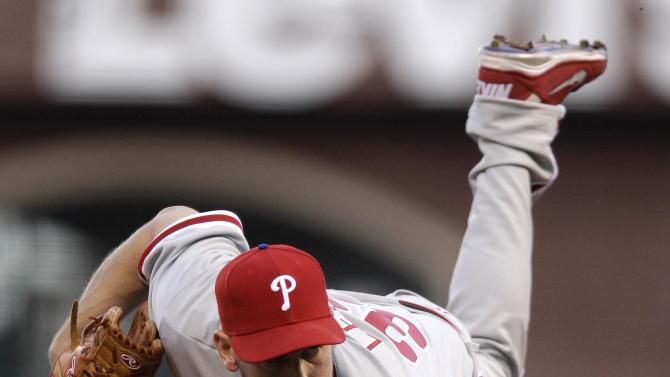 Philadelphia Phillies starting pitcher Cliff Lee throws to the San Francisco Giants during the first inning of a baseball game in San Francisco, Wednesday, April 18, 2012. (AP Photo/Marcio Jose Sanchez)