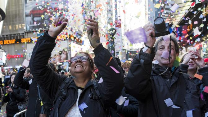 "People watch as confetti falls during the annual ""air worthiness"" test in preparation for New Year's Eve celebrations in Times Square, New York"