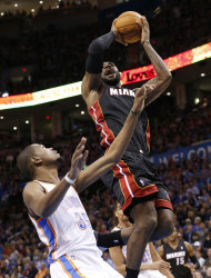 Miami Heat forward LeBron James (6) is fouled by Oklahoma City Thunder forward Kevin Durant (35) during tthe first quarter of an NBA basketball game in Oklahoma City, Thursday, Feb. 20, 2014. (AP Photo/Sue Ogrocki)