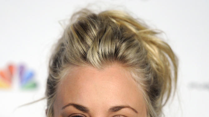 """FILE - This Dec. 5, 2012 file photo shows actress Kaley Cuoco at the Raising the Bar to End Parkinsons fundraising event at Public School 310 in Culver City, Calif. Cuoco, a star of CBS' """"The Big Bang Theory,"""" will join William Shatner a new commercial for Priceline, the online travel services company. (Photo by Chris Pizzello/Invision/AP, file)"""